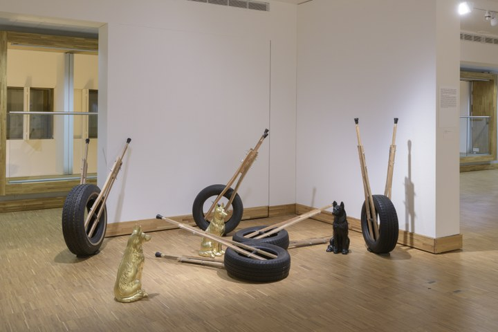 Kemang Wa Lehulere, The messengers or The knife eats at home,  2016. Rubber tyres, rubber fittings, steel, wood, earth, ceramic dogs, dimensions variable, Courtesy the artist and Stevenson Gallery, THE EKARD COLLECTION